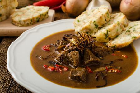Classic Czech goulash with dumplings, delicious heavy food, homemade Karlovarsky dumplings 스톡 콘텐츠