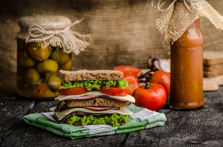 smoked: Sandwich with fresh smoked meat, cheese, lettuce and tomato with homemade ketchup Stock Photo