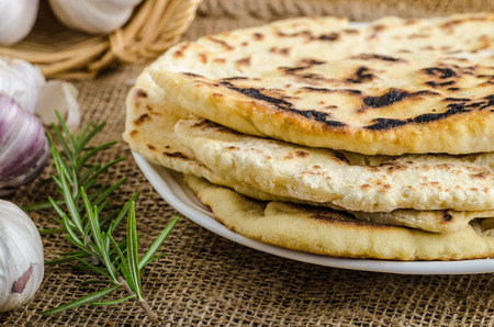 whole grains: Indian bread with rosemary, garlic and olive oil Stock Photo