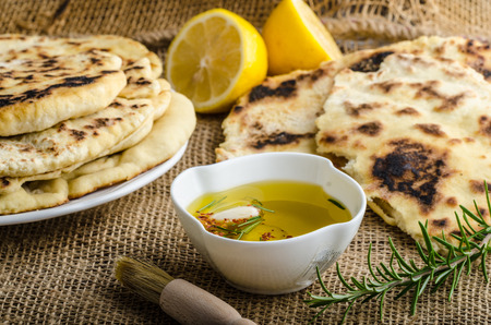 Indian bread with rosemary, garlic and olive oil Stock Photo