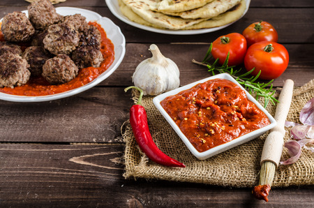 Indian lunch - meat balls with naan bread and spicy tomato sauce
