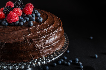 cakes and pastries: Three flour chocolate cake with berries