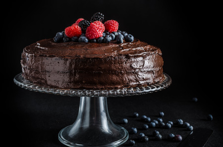 cake with icing: Three flour chocolate cake with, without berries