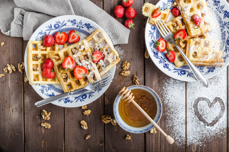 food       plate: Homemade waffles with honey and strawberries, little nuts for valentine Stock Photo