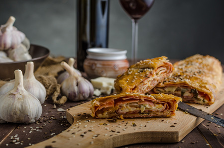 Savory strudel with ham, cheese and garlic