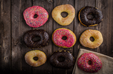 pinky: Homemade donuts, big one for bigger hunger, chocolate pinky and suger, american cap morning, place for advertising