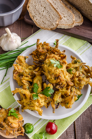 onion bhaji: Crispy onion bhajis, delicious street food, with herbs and garlic