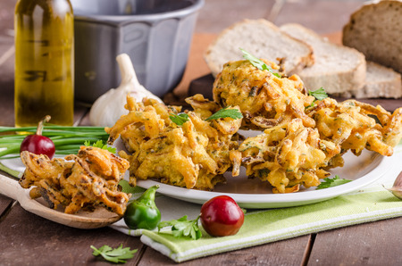 pakistani food: Crispy onion bhajis, delicious street food, with herbs and garlic