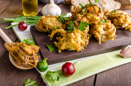 fritter: Crispy onion bhajis, delicious street food, with herbs and garlic