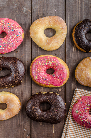 suger: Homemade donuts, big one for bigger hunger, chocolate pinky and suger, american cap morning, place for advertising