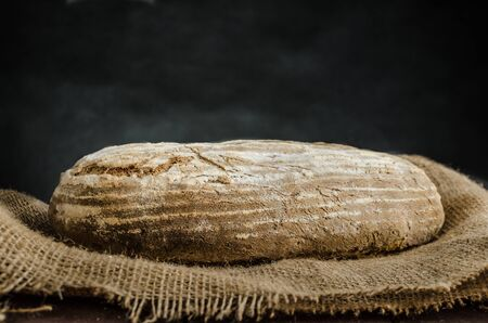 cake factory: Home baked bread from sourdough rye, rustic bread, place for your advertising, text