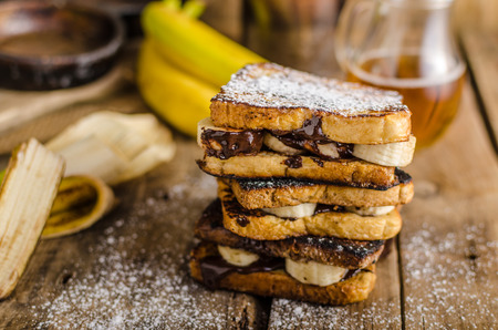 toast: French toast filled banana and chocolate, rustic picture, place for your advertising, beer behind on scene Stock Photo