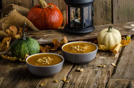 pumpkin soup: Halloween pumpkin soup with roasted pumpkin seeds, delicious and scary!!! Stock Photo
