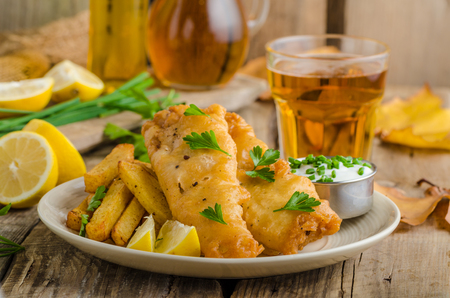 Fish and chips. Fish wrapped in beer batter, herbs dip and czech beer