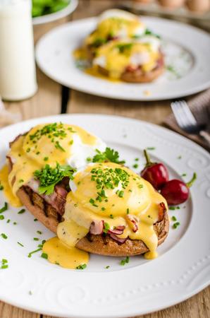 benedict: Eggs Benedict with little salad, milk and fresh herbs