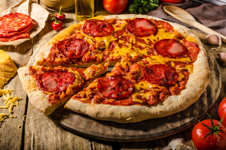 chorizo: Rustic salami pizza with cheddar cheese and chorizo, delicious chorizo - spain rustic salami with red cheddar.