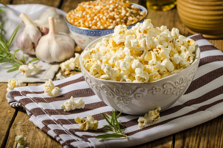 popcorn kernel: Domestic organic popcorn with herbs Stock Photo