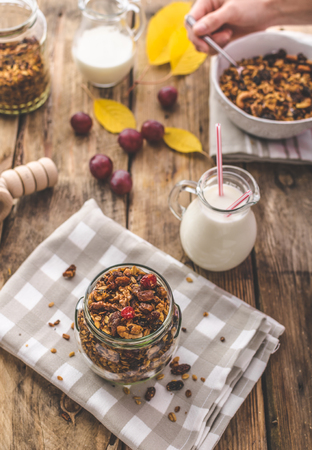 carbohydrates: Home-baked granola with nuts, honey and pieces of fruit, full of protein and carbohydrates Stock Photo
