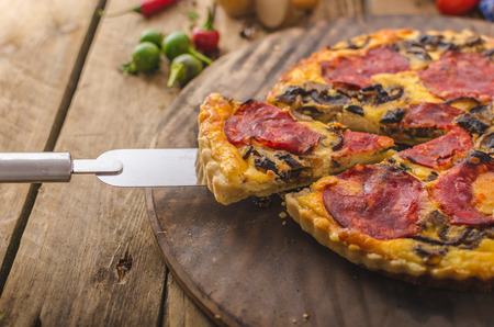 breakfast: Delicious quiche with chorizo, nuts and sharp cheese Stock Photo