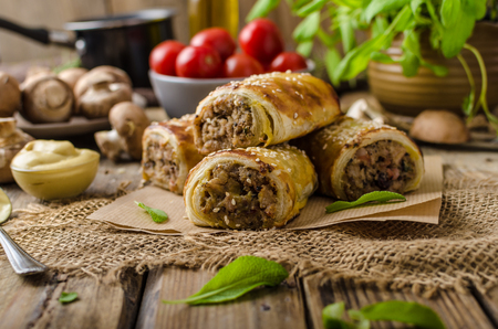 pork sausage: Sausage Roll delicious recepy from mushrooms, czech hogkilling sausage and puff pastry Stock Photo