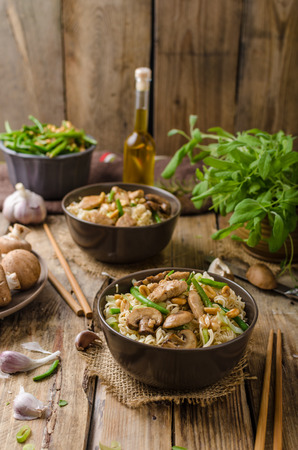 chinese meal: Chinese noodles with brown mushrooms, simple and delicious fast food. Stock Photo