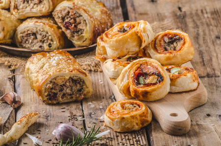 pastry: Sticks puff pastry, topped with spice, baked in oven, rustic photo