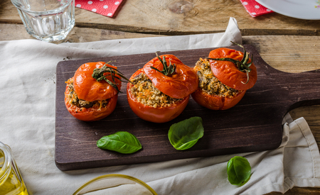 Baked tomatoes stuffed with herbs, delicious vegetarian meal