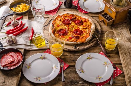 four people: Rustic salami pizza with chorizo, whole table for four people