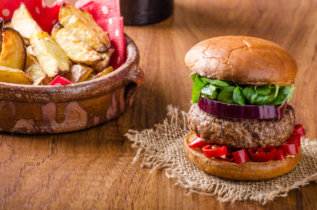 seasoned: Beef burger with chilli, homemade bun and delicious beef seasoned meat with spicy chilli