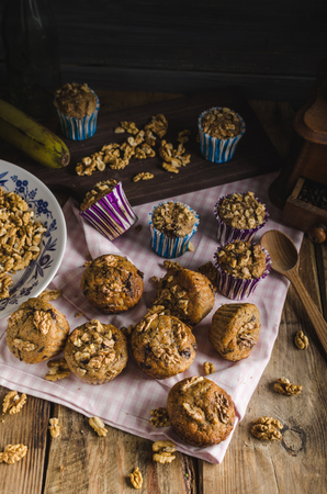 blueberry muffin: Whole grain muffins with dark chocolate and nuts, rustic style