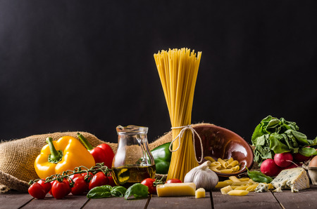 san: Still life photo, background with pasta and cheese, delicious san marzano tomatoes Stock Photo
