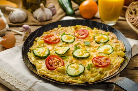 Vegetable frittata with tomatoes, potatoes and cucumber