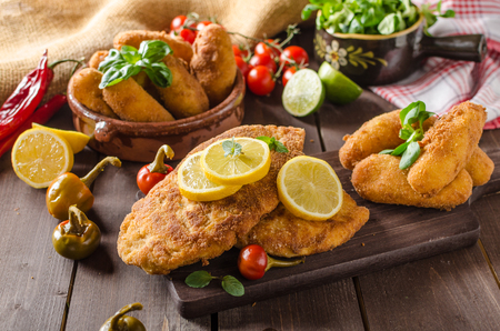 Chicken schnitzel and homemade potato croquettes with cheese and chilli Stock Photo