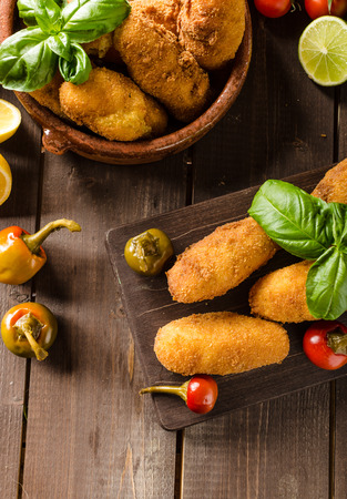 Homemade potato croquettes with cheese and chilli, very simple to do and delicious Archivio Fotografico