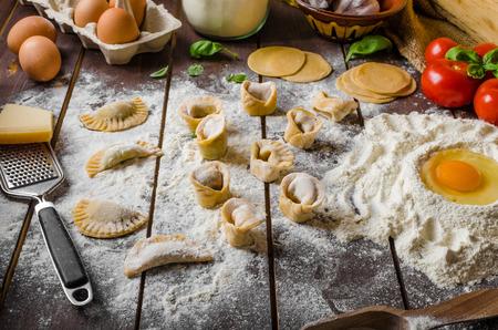 stuffed tortellini: Preparing homemade pesto tortellini stuffed with cheese