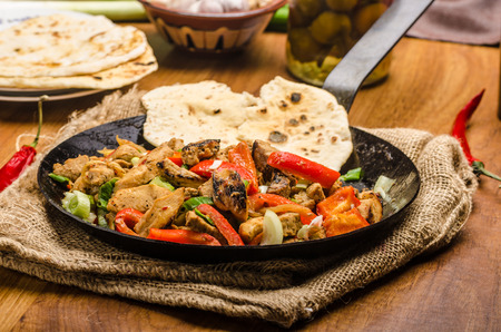 doufu: Sichuan meat mix with vegetables and homemade naan bread