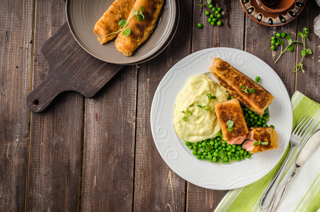 crust: Fried salmon in herb crust with peas and mashed Stock Photo