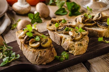 styled: Rustic Toast bread with garlic, mushrooms and herbs, rustic styled photo