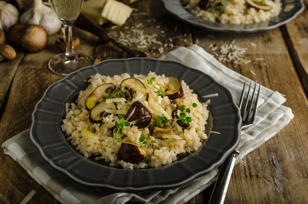 Original italian risotto with mushrooms and parmesan cheese