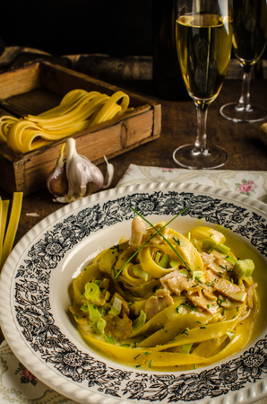 semolina pasta: Tagliatelle with chicken curry, champagne and homemade pasta for best flavouor Stock Photo