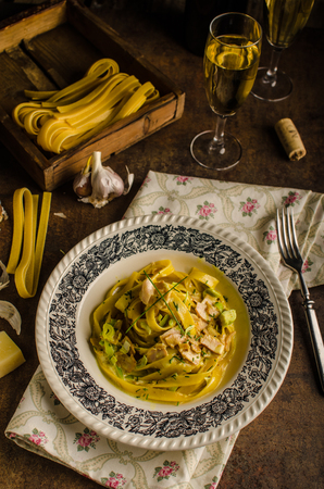 chicken curry: Tagliatelle with chicken curry, champagne and homemade pasta for best flavouor Stock Photo