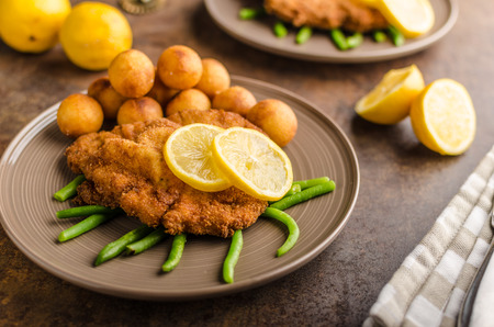 wiener: Wiener schnitzel with potato croquettes and beans, lemon freshened