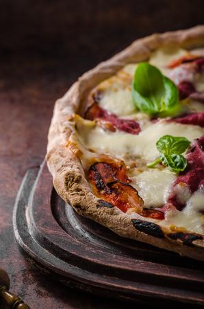 margherita: Delicious original italian margherita pizza, dark picture Stock Photo