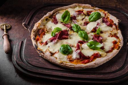 pizza crust: Delicious original italian margherita pizza, dark picture Stock Photo