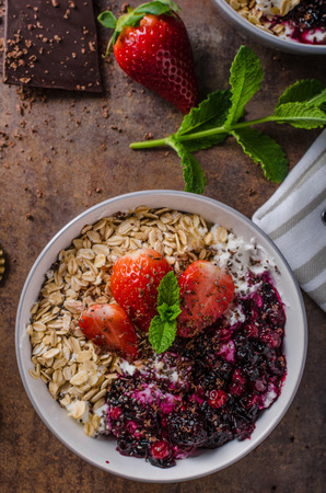 sprinkled: Granola with berries and strawberries sprinkled with dark chocolate