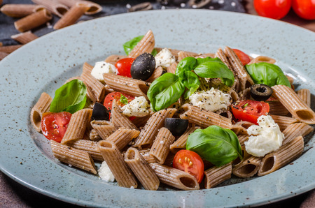 Whole grain pasta with cheese, tomato and basil