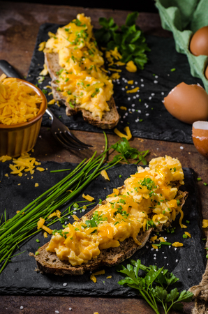 chive: Scrambled eggs on sourdough bread with chive and cheese Stock Photo