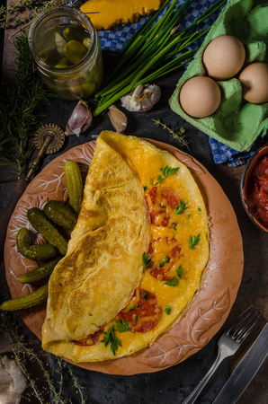 cheddar cheese: Omelet with chorizo and cheddar cheese, with bio pickes