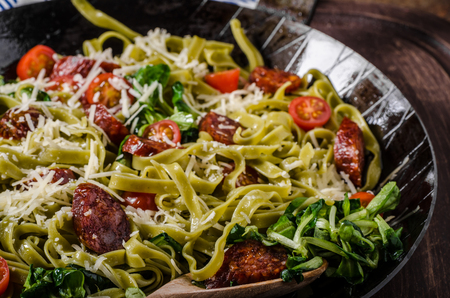 topped: Pasta salad with sausage, topped with parmesan cheese