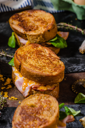 melted cheese: French toast with ham and cheese, melted cheese inside Stock Photo